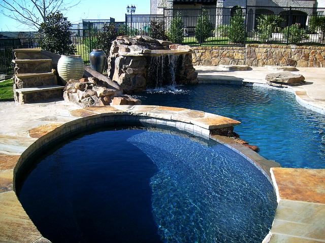 16 amazing pool designs the home touches for Amazing pool designs