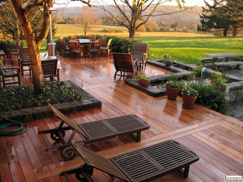 Bring symmetry into play to create an outdoor oasis the for Large deck designs