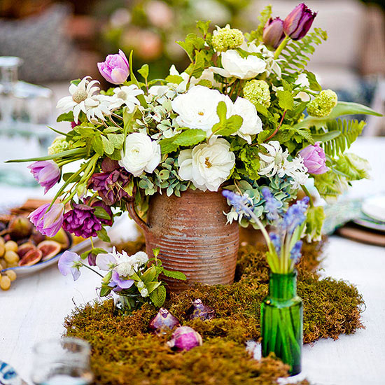 Get spring wedding centerpiece ideas, featuring seasonal flowers and colors. Arrangements like these will help you take advantage of the beautiful bounty and natural colors of the season.